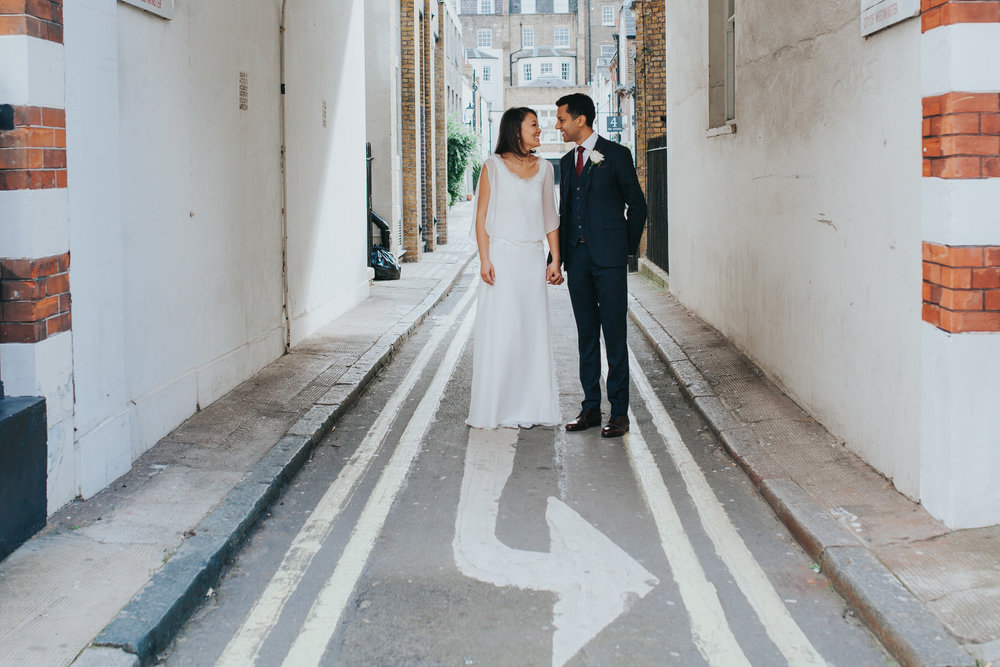 bride groom portrait arrow street signage Marylebone London