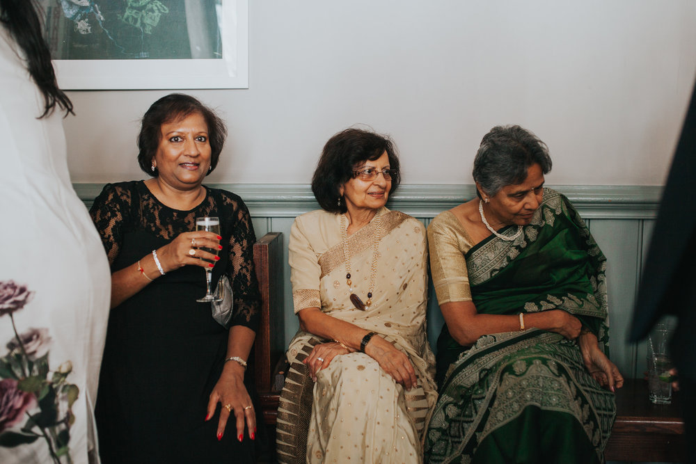aunties dressed in wedding sari London documentary wedding photographer