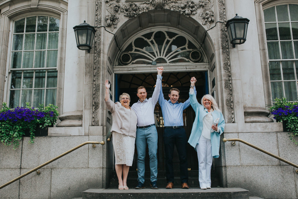 15 same-sex wedding couple celebrate steps Chelsea Town Hall.jpg