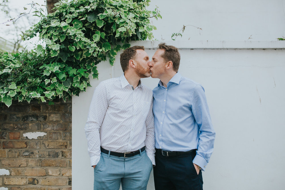 103 same-sex couple kissing after equal marriage ceremony London.jpg