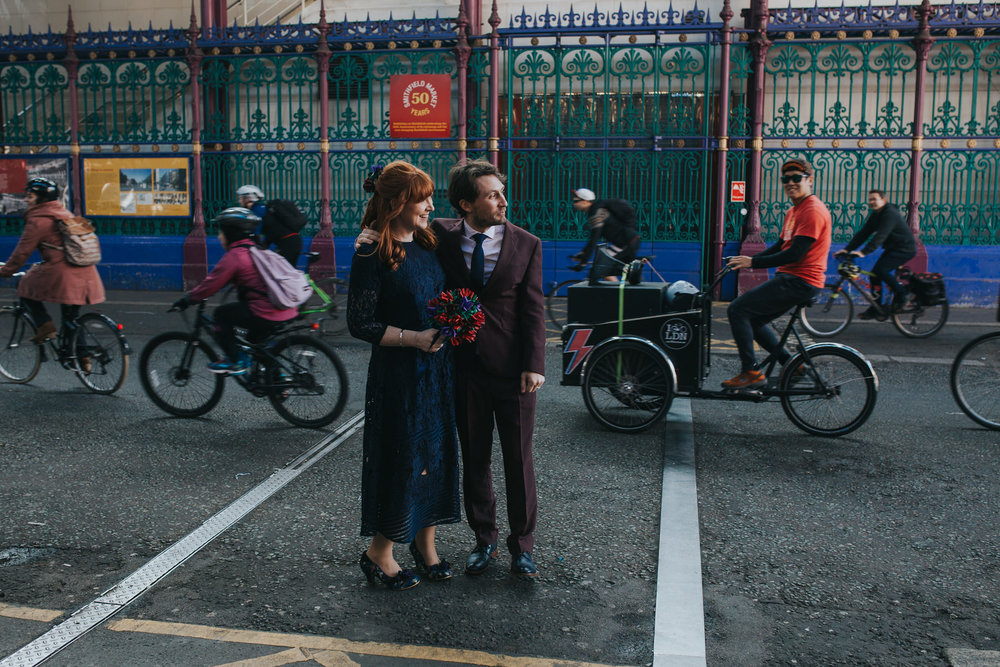 172 bride groom flash mobbed cyclists Smithfields wedding.jpg