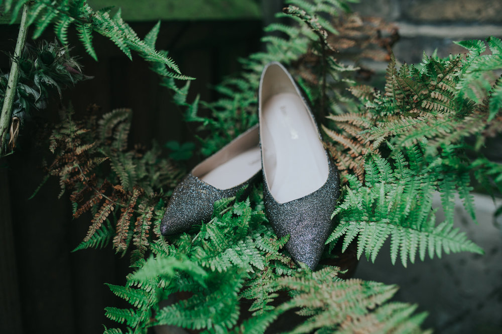 11-bride getting ready silver flat wedding shoes in ferns.jpg