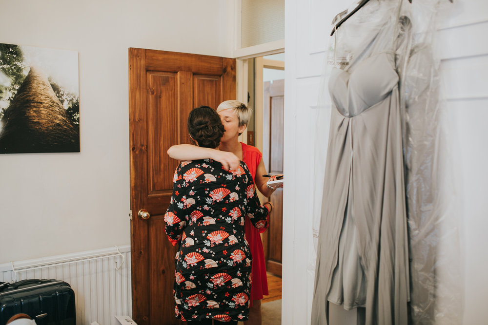 18-bride getting ready bridesmaid hugs.jpg