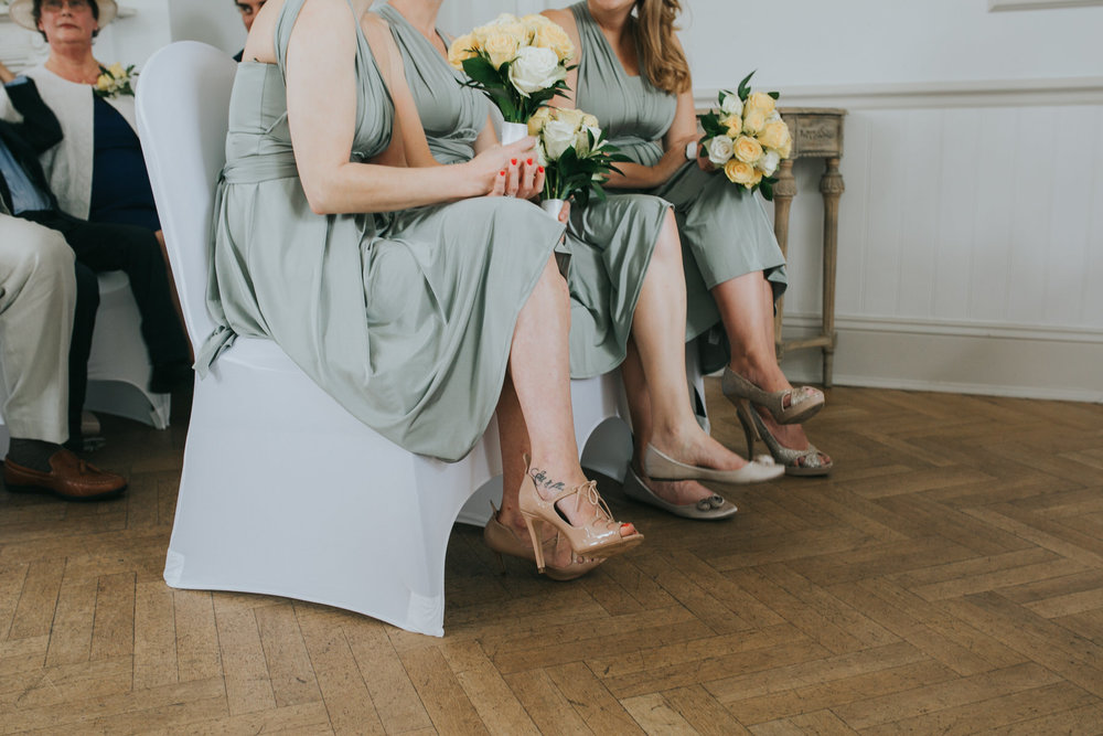 110 bridesmaids shoe shot parquet floor Belair House.jpg