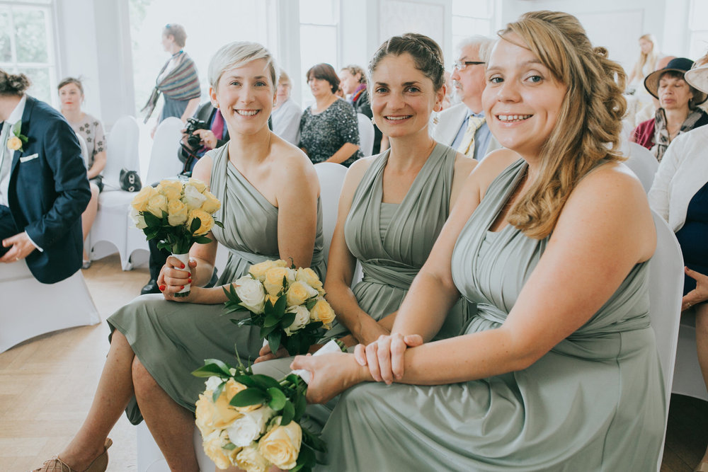 111 happy bridesmaids wearing mint dress yellow rose bouquets.jpg