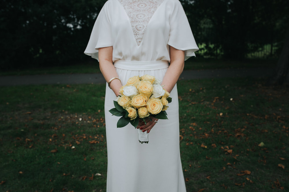 157 London bride portrait yellow rose bouquet.jpg