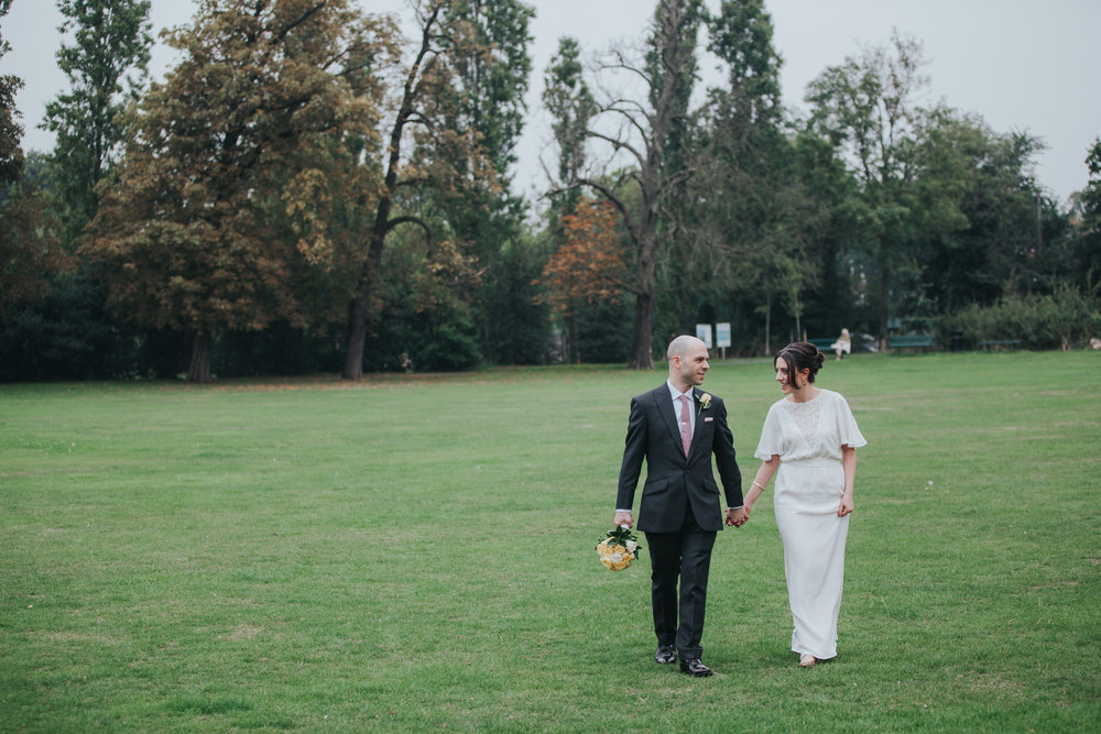 163 bride groom walk through Belair Park Dulwich wedding.jpg
