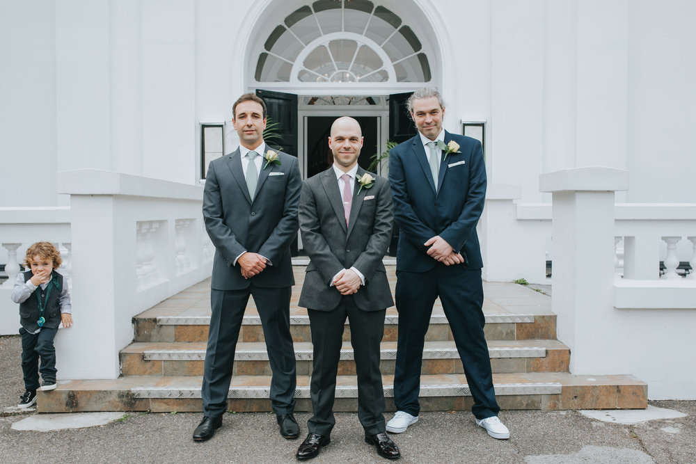 225 photobombing groom and bestmen formal photo.jpg