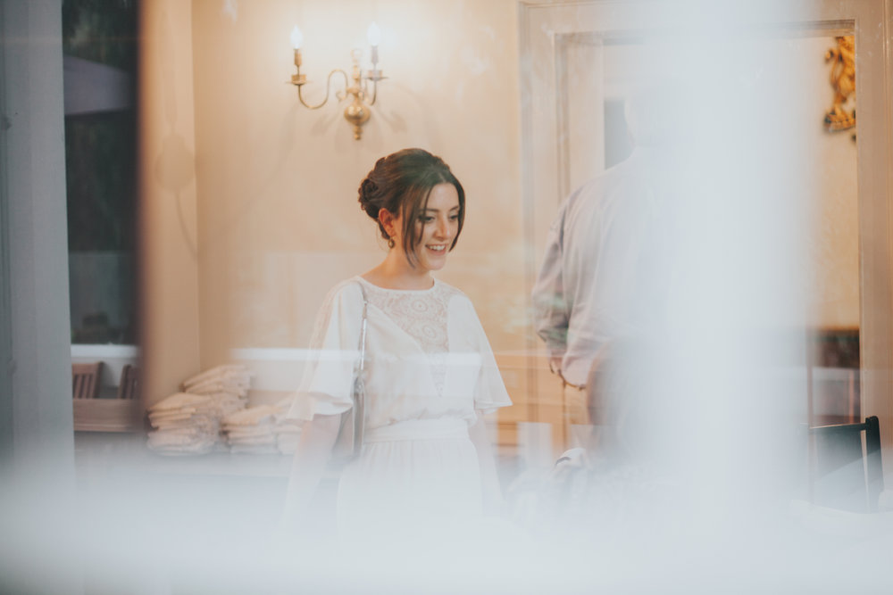 260 bride through Belair House window.jpg