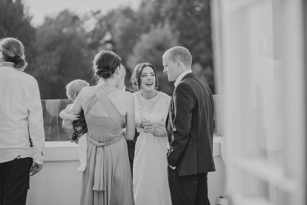 291 London reportage bride groom sunset drinks balcony.jpg