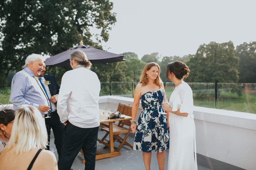 296 London wedding guests sunset drinks balcony.jpg