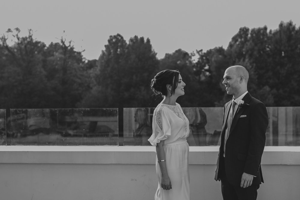 307-Belair House bride groom sunset drinks balcony.jpg