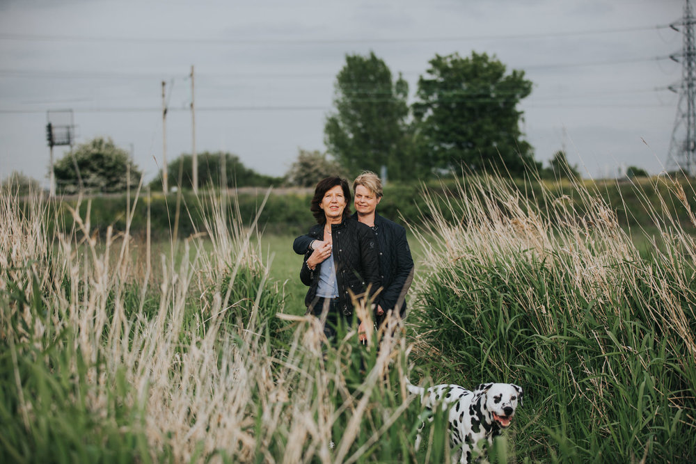 20 lesbian couple posing dalmation dog between reeds London marshes .jpg