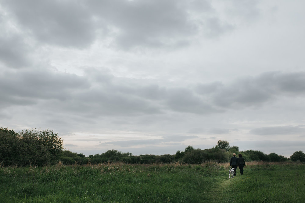 91 moody skies Hackney marshes relaxed engagement shoot dalmatian dog.jpg