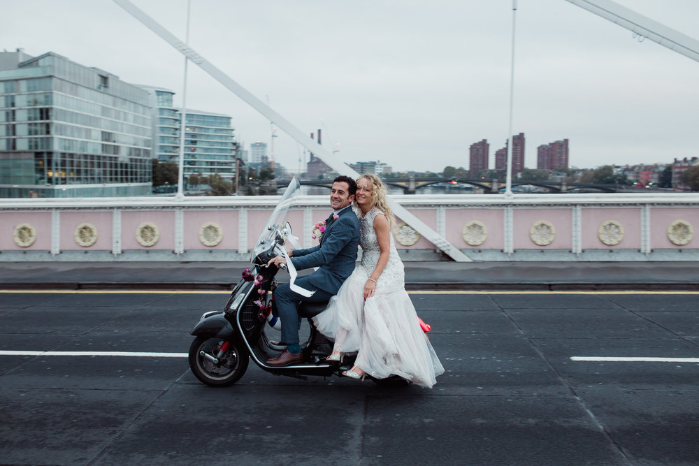 bride room vespa over Chelsea Bridge sunrise post wedding shoot.jpg