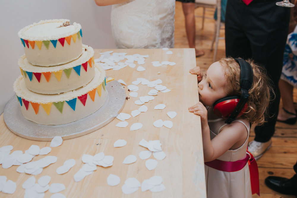 Lea Rowing Club wedding flower girl eying up wedding cake.jpg