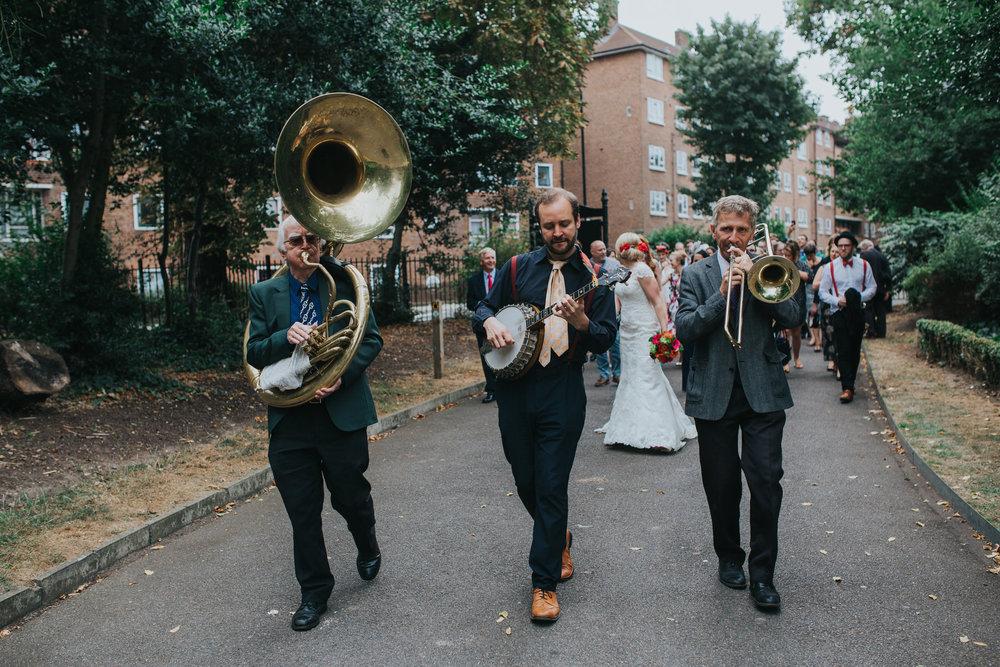 Brass band leading wedding party through park to reception.jpg