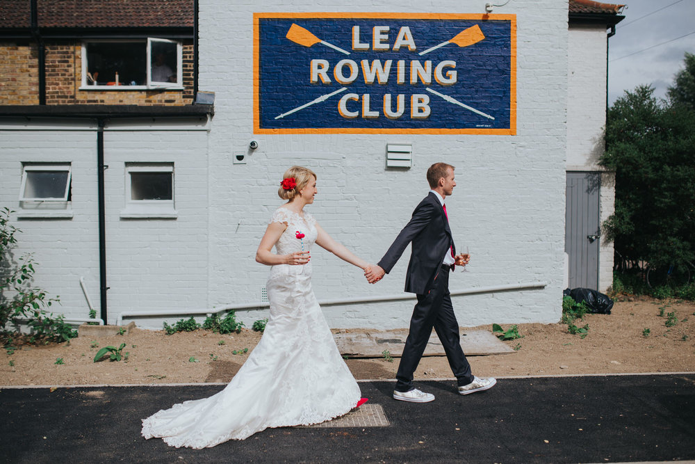 bride groom walking Lea Rowing Club house Hackney.jpg