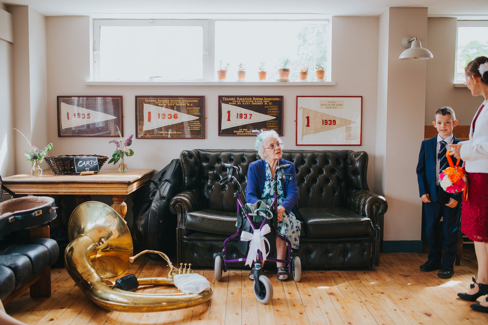 Lea Rowing Club wedding grandma relaxexing near trombone.jpg