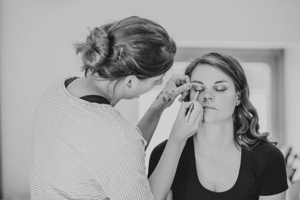 5 BW makeup artist during bridal prep Forest wedding.jpg