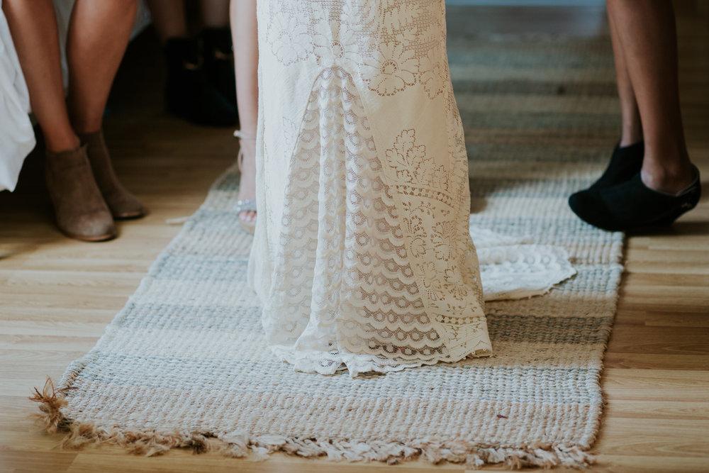 8 texture of cream crocheted wedding dress on woven rug.jpg