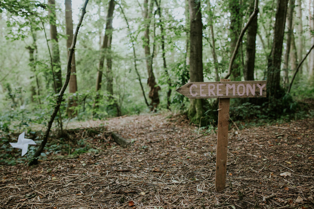 17 ceremony sign in woodland Paper Mill forest wedding East Sussex.jpg
