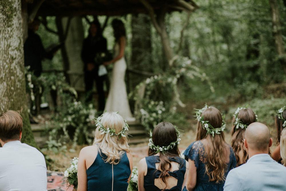 30 guests looking on bride groom woodland ceremony.jpg