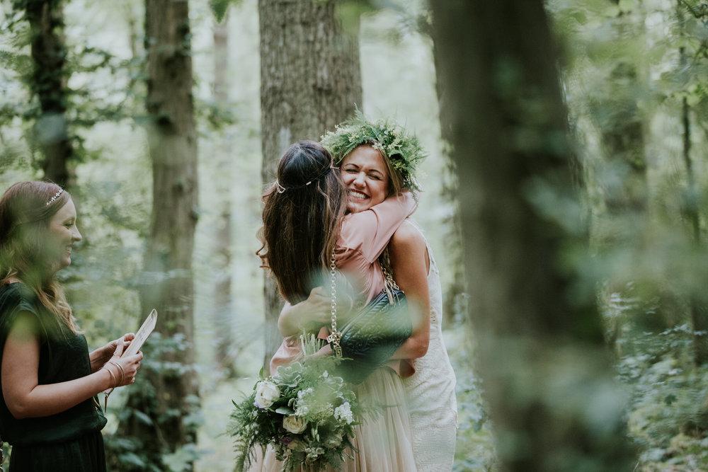 55 friend hugging bride woodland Kent.jpg
