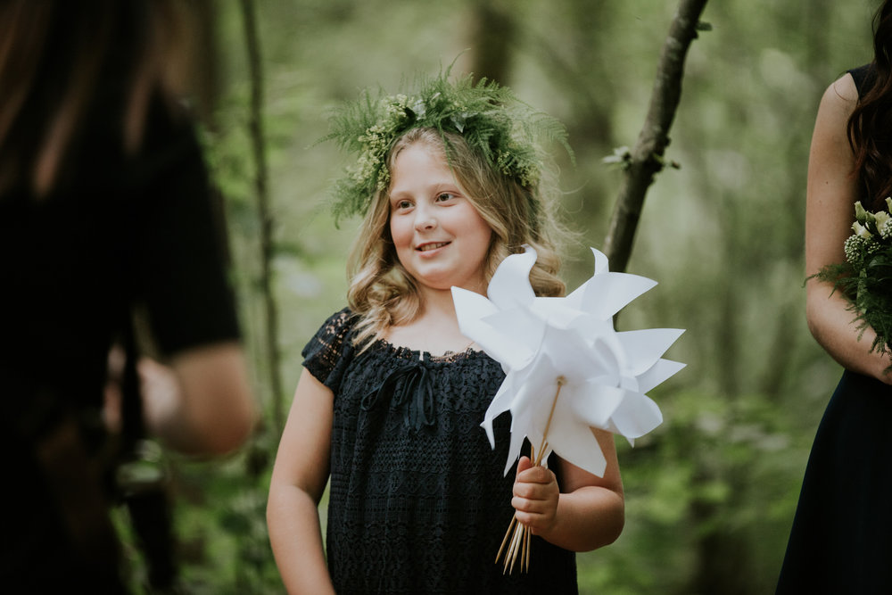 59 flower girl holding white origami windmill forest wedding.jpg