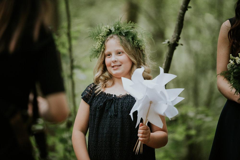59 flower girl holding white origami windmill forest wedding.jpg