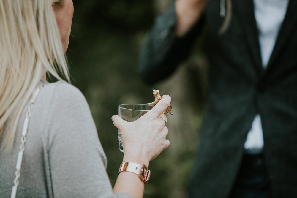 71 guest holding gold animal cocktail swizzler sticks wedding drink detail.jpg
