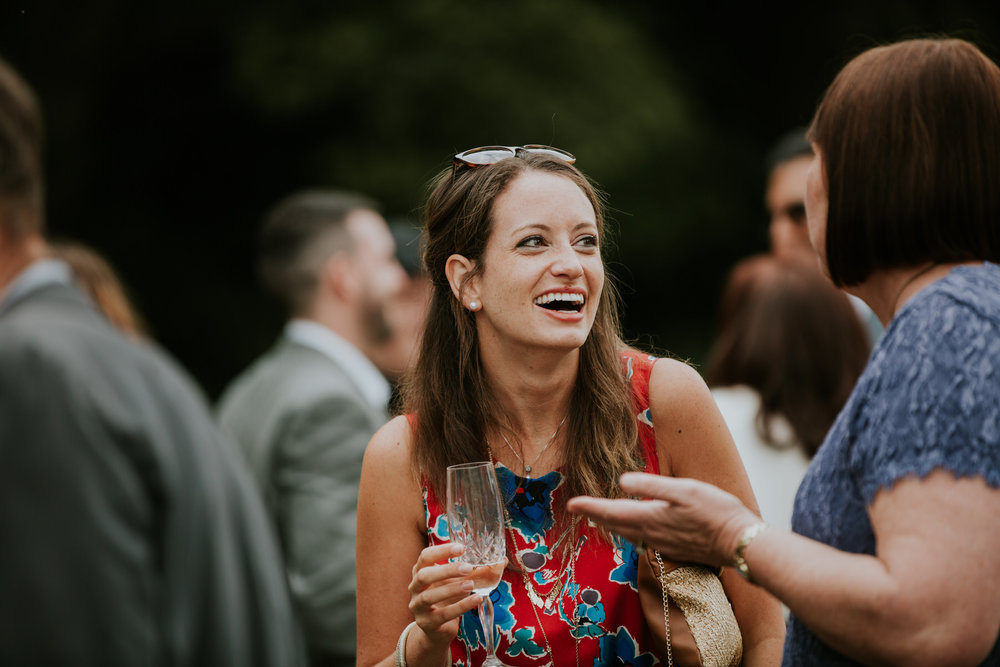 102 Kent woodland festival wedding guest laughing.jpg