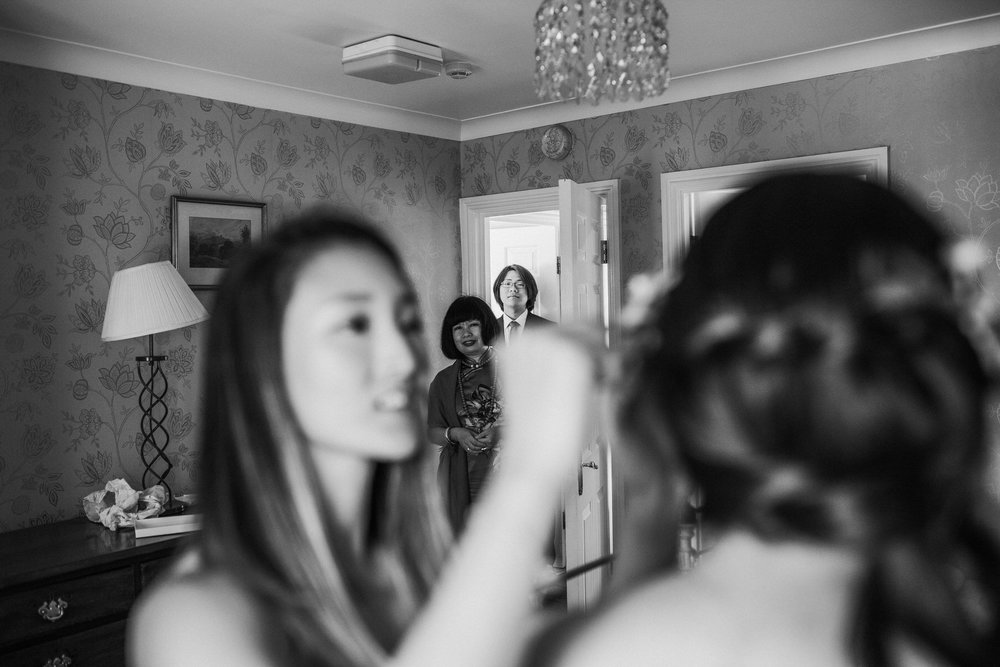 338 Portmeirion reportage bridal preparations mum peeking.jpg