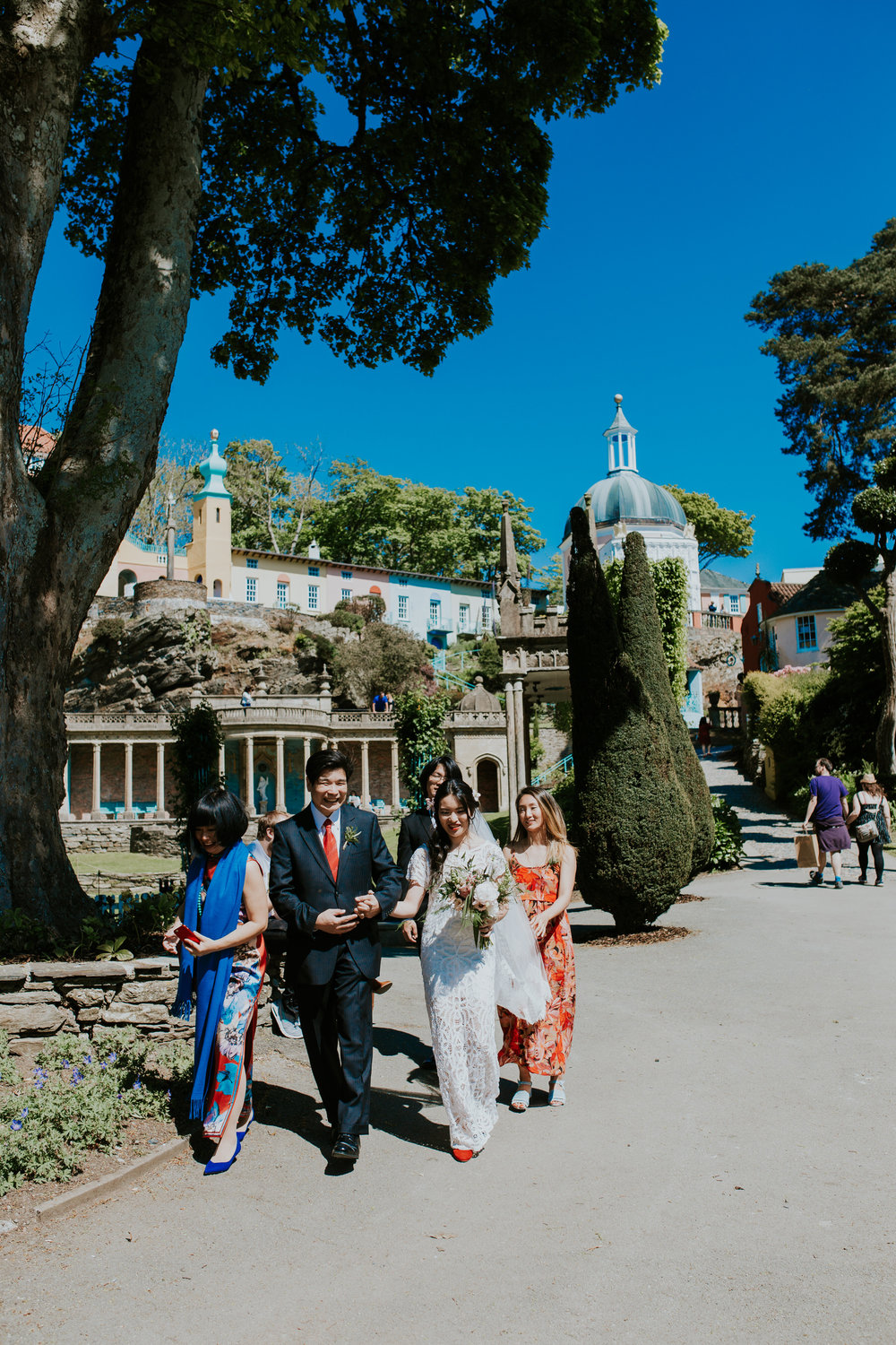 414 brides wedding party walking through Portmeirion.jpg