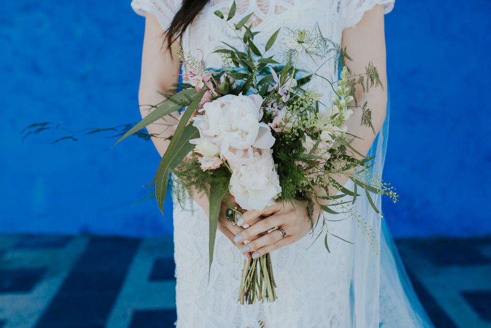 621 Shaina's wildflower wedding bouquet blue wall Portmeirion.jpg