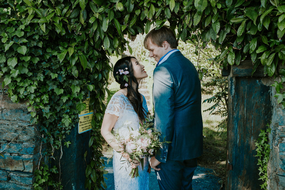 712 Portmeirion bride groom wedding portrait green arch.jpg