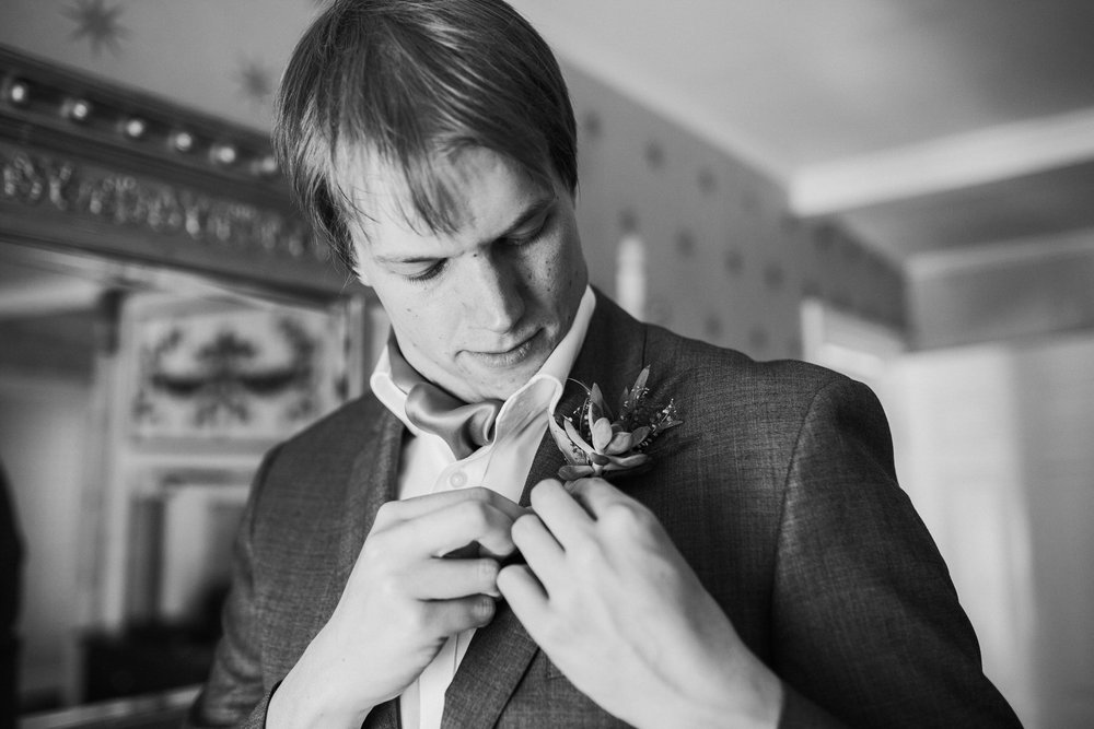 300 groom attaching buttoneire Portmeirion wedding.jpg