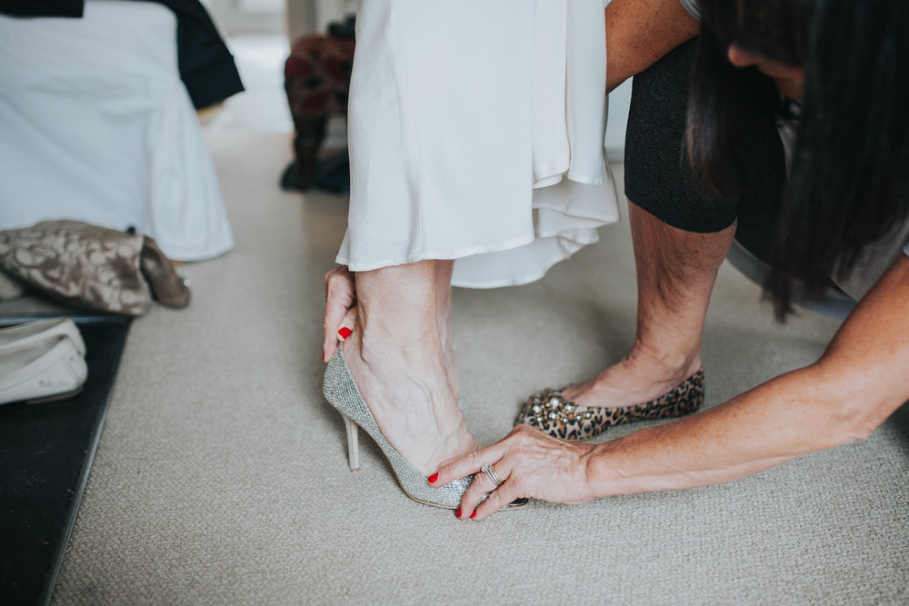 29 put on Jimmy Choo wedding shoes London.jpg