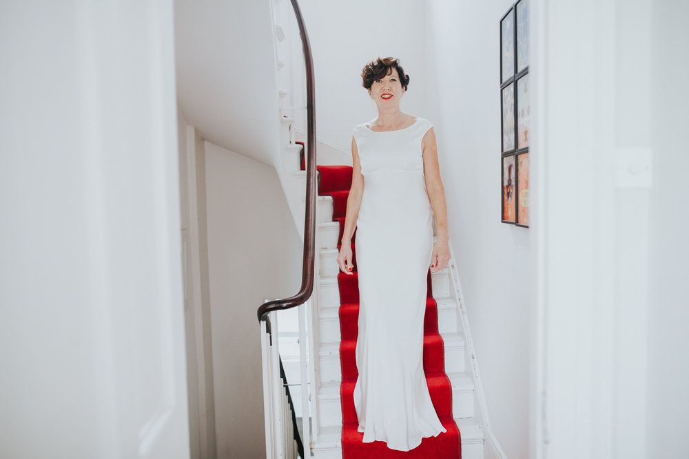 43 elegant bride on stairs Islington wedding photographer.jpg