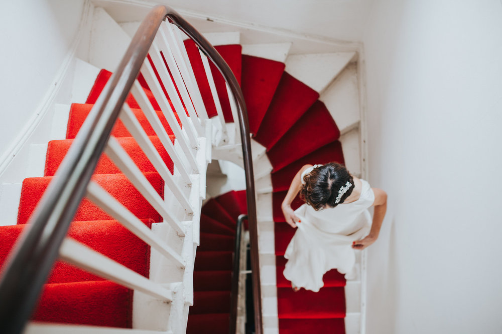 44 bride walking down stairs bridal preparations.jpg