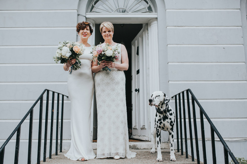 66 Islington brides wedding portraits grey wall dalmatian dog.jpg