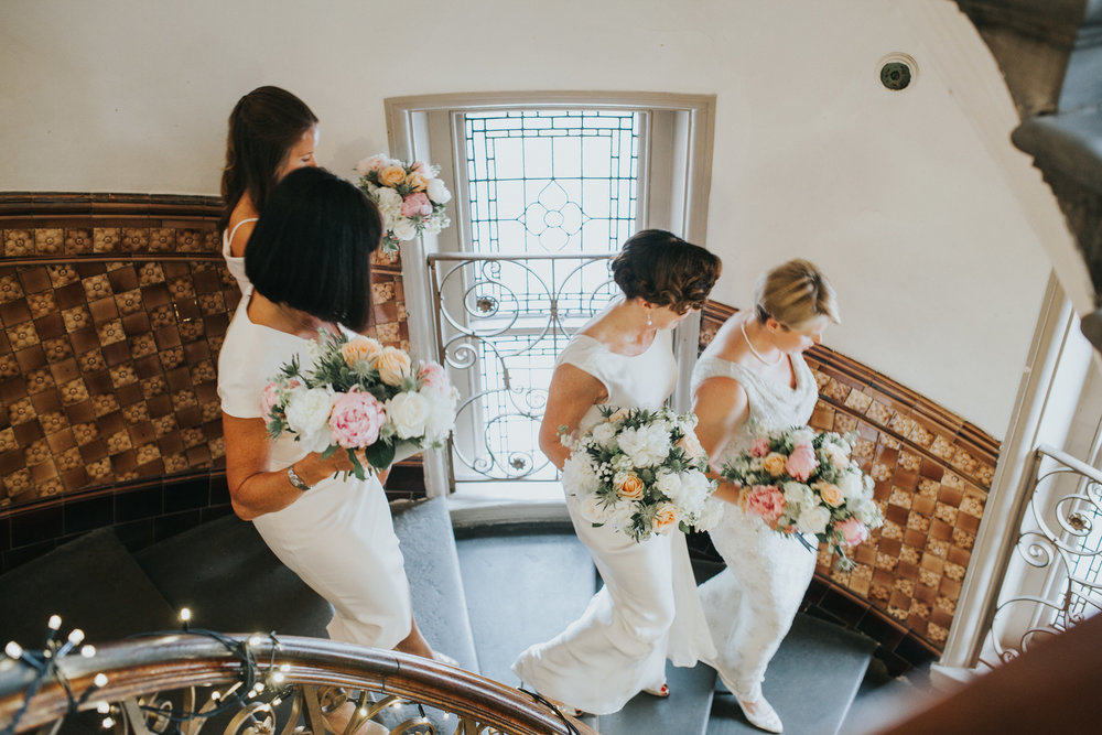 124 brides bridal party staircase Finsbury Town Hall wedding.jpg