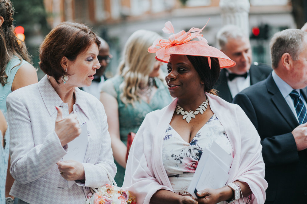 137 wedding guests wearing pink Finsbury Town Hall reportage photographer.jpg