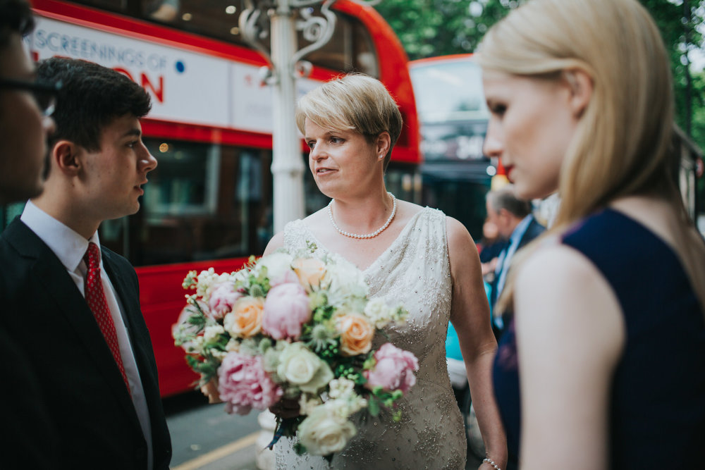 139 bride outside Finsbury Town Hall reportage wedding.jpg