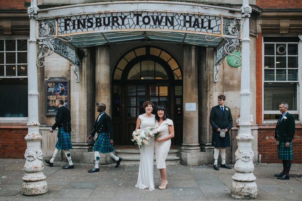 141 bride posing sister Finsbury Town Hall.jpg