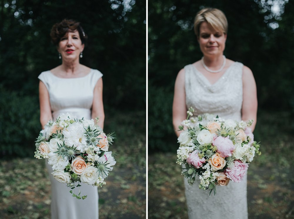 167 two brides hoding bouquet thistle blush peony white rose.jpg
