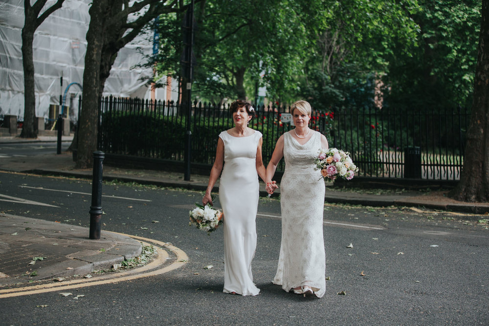 199 London reportage two brides walking couple portraits.jpg