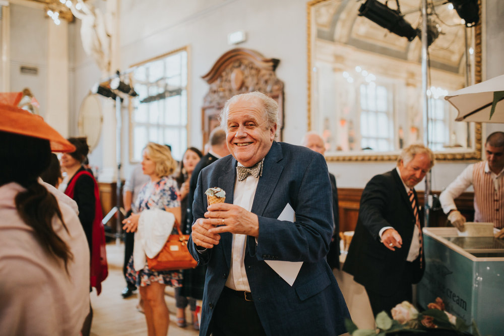 256 Old Finsbury Town Hall wedding guest eating icecream.jpg