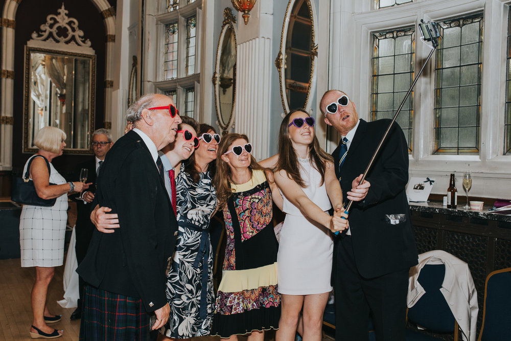 262 Islington wedding guests selfie stick.jpg