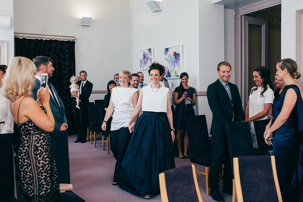 CV-204 two brides enter Leeds registry office wedding photographer.jpg